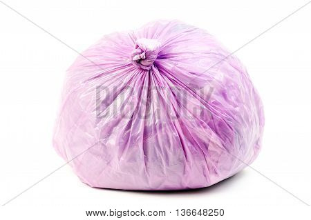 Purple rubbish bag isolated on a white