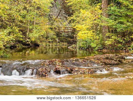Autumn colors reflect in Cedar Creek, at Natural Bridge, Virginia.