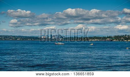 A view of the skyline in Bellevuie Washington. Lake Washington in the foreground.