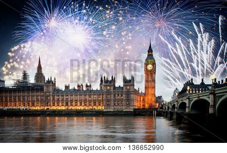 Fireworks over Big Ben Clock Tower and Parliament house at city of westminster, London England UK