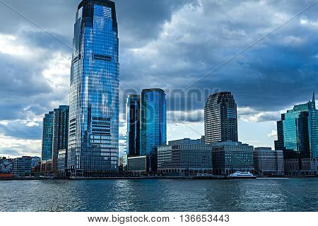 Low Angle Architectural View of Modern Glass Skyscrapers Featuring One World Trade Center Building Against Blue Sky, Manhattan, New York City, New York, USA