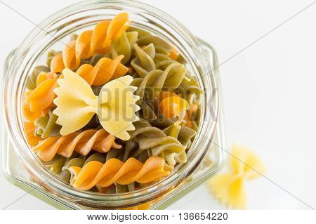Various Pasta In A Glass Jar On A White