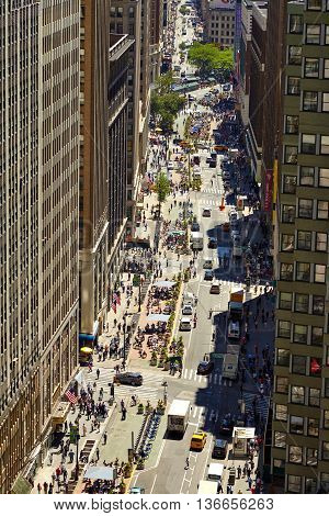 NEW YORK, USA - JUNE 14, 2016: View down a busy street in Manhattan, New York City, USA