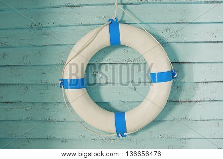 Retro lifebuoy on old wooden walll background