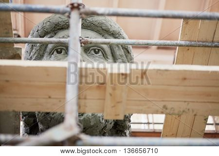 RUSSIA, MOSCOW - MAY 28, 2015: Scaffolding and fragment of head of clay sculpture to St. Prince Vladimir during manufacture in the workshop of sculptor Salavat Shcherbakov.