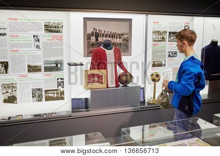 MOSCOW, RUSSIA - MAY 26, 2015: Boy (with model release) at the Locomotive soccer club museum. Museum was opened on November 24, 2011.