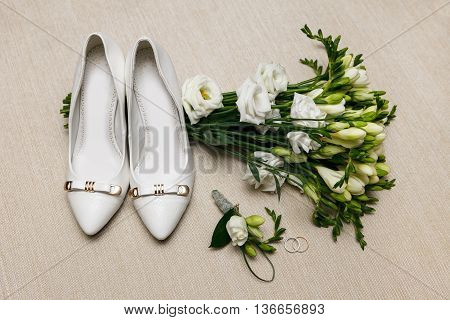 wedding bouquet and bridesmaid shoes boutonniere and ring