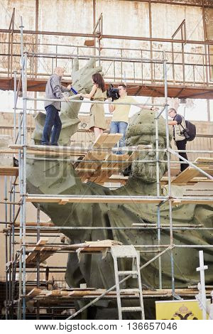 RUSSIA, MOSCOW - MAY 28, 2015: Press representatives take interview near clay sculpture to St. Prince Vladimir during manufacture in the workshop of sculptor Salavat Shcherbakov.