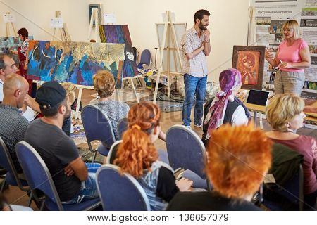 MOSCOW, RUSSIA - JULY 27, 2015: Participants of the International Symposium of Painting First Moscow International Art Fair at Izmailovo Kremlin in Moscow.