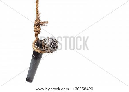 Broken microphone hung on a rope - Threatening press freedom concept