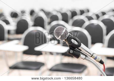 A microphone in an empty university classroom