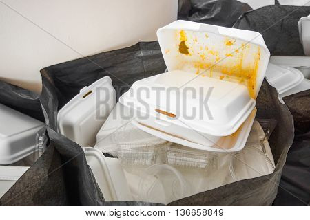 Foam food containers in the bin - Takeaway food and environmental problems concept