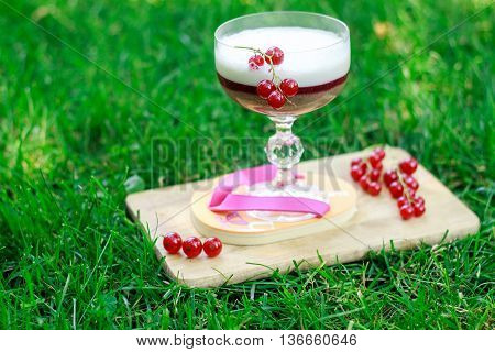 Milk Cocktail With Black Currant, Red Currant, Banana, Raspberries And Ice Cream. Glass On A Beautif
