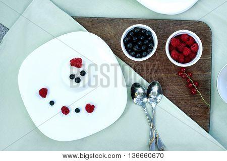 Healthy Breakfast. Oatmeal Porridge, Banana, Raspberries, Blueberries, Red Currants, Pumpkin Seeds A