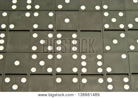 background of different plastic dominoes chips closeup