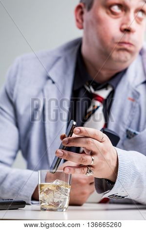 Manager Putting His Smartphon On Alcohol