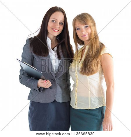 Two young business women stand on a white background.