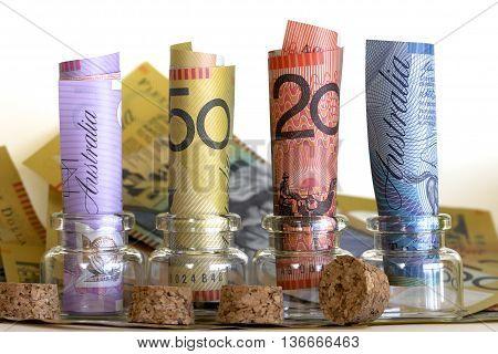 Some jars full of rolled Australian dollars.