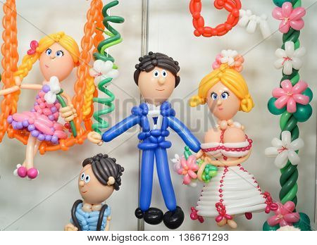 Bride and groom colorful twisted ballons. Love and wedding concept.