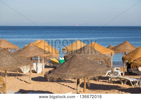 Umbrellas On Seaside Beach
