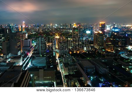 Aerial view of Bangkok city at night. View from above of modern Asian megalopolis cityscape at night