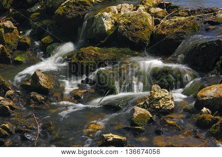 Small waterfall on a stony stream. Poland, Holy Cross Mountains.
