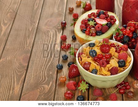 Corn flakes with berries for breakfast close up