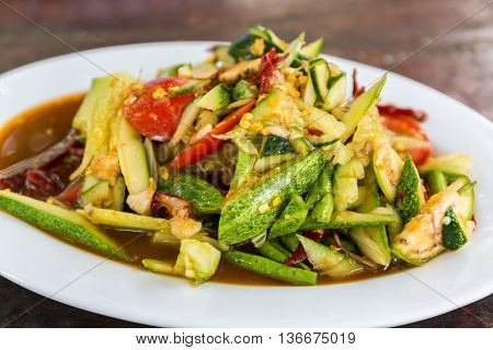 Spicy cucumber salad that is one type papaya salad. Som Tum spicy thai food.