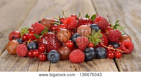 Various berries on a brown background close up