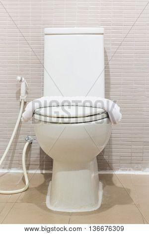White Ceramic toilet bowl in a bathroom