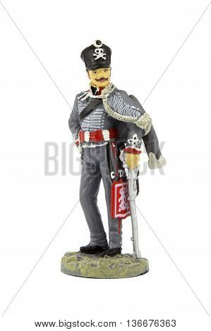 Toy tin soldier on a white background