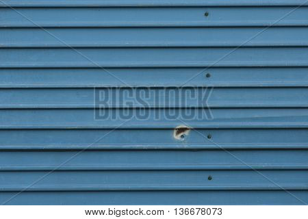 blue horizontal metal wall with rusty abrasion texture background