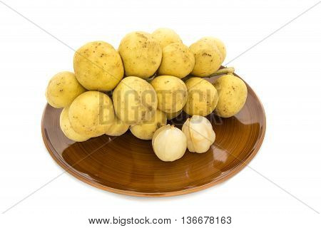Wollongong delicious fruit or Longkong fruit or Lansium parasiticum in plate is tropical fruit in south east Asia on white background