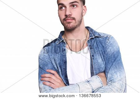 Portrait of attractive young man against isolated white background.