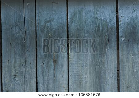 wooden boards with a blue tint in the upright position boards