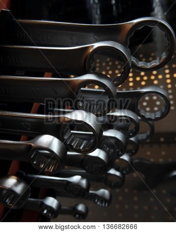 Heads of box wrenches on the showcase of hardware store