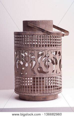 metal hand lamp for candles on a gray background