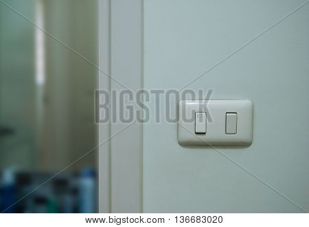 The Light Switch on the wall in home
