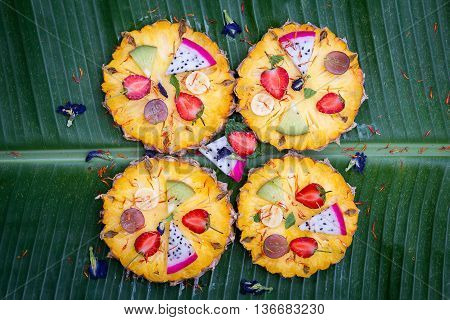 Tropical fruit pizza with pineapple strawberry kiwigrapes banana and dragon fruit
