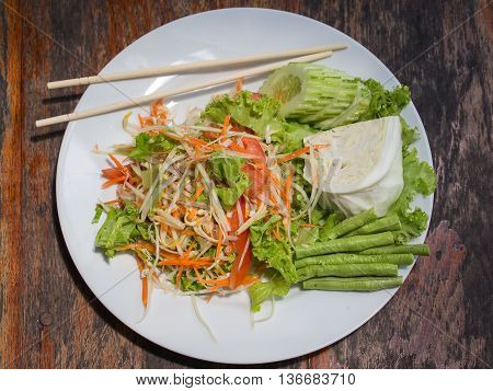 Vegetarian Thai papaya salad also known as Som Tam from Thailand . Close up
