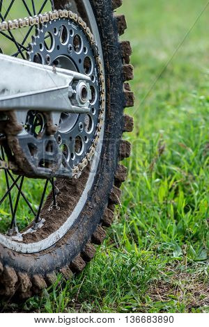 Rear wheel motocross bike after a workout in the mud close-up