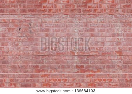Weathered stained old brick wall background texture