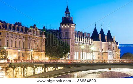 The castle Conciergerie in evening Paris France.
