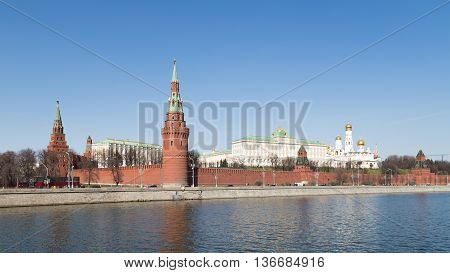 Moscow - April 12 2015: View towards the Kremlin and the Kremlin embankment across the Moscow River and the Kremlin green lawn in early spring April 12 2015 Moscow Russia