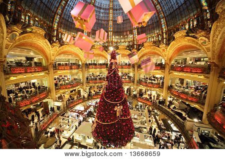 PARIS - DECEMBER 30: The Christmas tree at Galeries Lafayette, trade pavilions with perfume, view from the upper gallery, December 30, 2009, Paris, France. This store is one of the symbols of Paris.