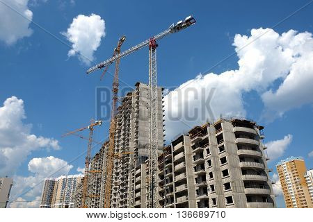 New high-rise modern apartment buildings construction in process ob bright sunny day side view horizontal