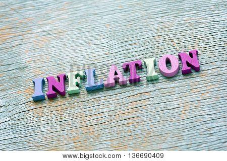 Word Inflation On Vintage Wooden Background