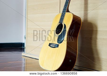 Electric Guitar lying on wooden cabinet background