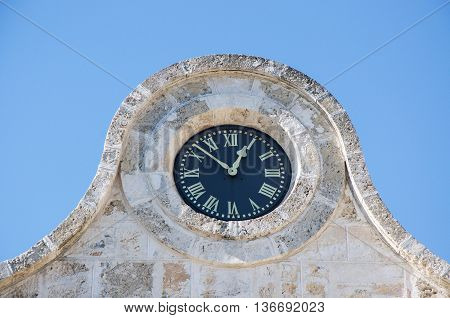 FREMANTLE,WA,AUSTRALIA-JUNE 1,2016:  Fremantle Prison clock detail under a clear blue sky in Fremantle, Western Australia.
