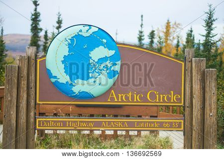 arctic circle sign Dalton Highway Alaska in fall